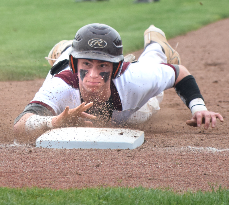 William D. Lewis The Vindicator  South Range's Jared Bajerski(18) dives back to first in a pick off attempt during 5-16 action with Crestview.