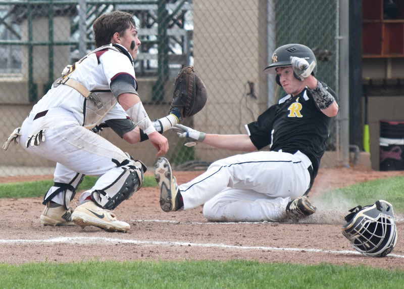 William D. Lewis The Vindicator  Crestview's Keith Berger(20) is out as South Range catcher Jared Bajerski(18) makes the tag during 5-16 action at Cene.
