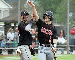 William D. Lewis The Vindincator Canfield's Anthony Longo(1) gets congrats from Alex Hernandez(34) after scoring during win over Niles 5-17-18.