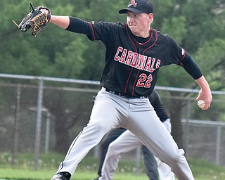 William D. Lewis The Vindincator Canfield'sIan McGraw(22) delivers during win over Niles 5-17-18.