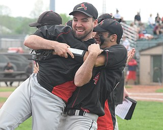 William D. Lewis The Vindincator Canfield assist coach Ryan Halicki is lifted up by Alex Hernandez(34) during win over Niles 5-17-18.