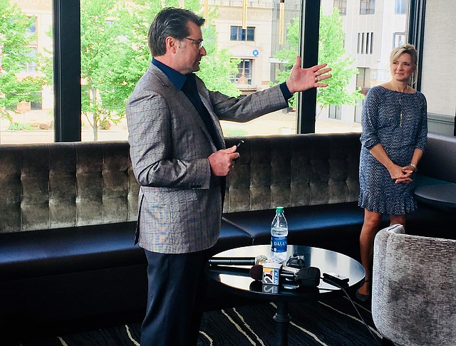Developer Dominic Marchionda and wife Jacqueline speak to the media during today's tour of the DoubleTree by Hilton on East Federal Street.