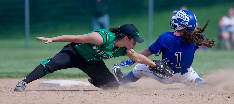 ALLIANCE, OHIO - MAY 17, 2018, Softball Poland Bulldogs vs West Branch Warriors: West Branch's Delaney Rito (22) tags out Poland's Brooke Bobbey(1) attempting to steal 2nd base during the 5th inning at Alliance High School.  MICHAEL G. TAYLOR | THE VINDICATOR