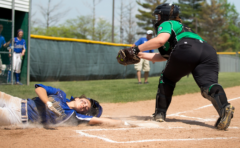 ALLIANCE, OHIO - MAY 17, 2018, Softball Poland Bulldogs vs West Branch Warriors: Poland's Sarah Bo-Cherry (12) eludes the tag of West Branch'sSam Morris (25)  scoring Poland's second run during the 1st inning at Alliance High School.  MICHAEL G. TAYLOR | THE VINDICATOR