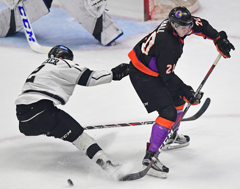 YOUNGSTOWN, OHIO - MAY18, 2018: Phantoms' Curtis Hall sakes with the puck while being check by Fargo's Robbie Stucker during Friday nights Clark Club Final game at the Covelli Centre. DAVID DERMER | THE VINDICATOR