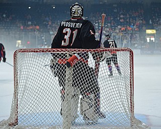 YOUNGSTOWN, OHIO - MAY 19, 2018: Youngstown goalie Ivan Prosvetov stands while Phantoms players skate around behind him during a delay for fog that built up on the ice during the first period of game 4 of the Clark Cup Final, Saturday night at Covelli Centre. DAVID DERMER | THE VINDICATOR