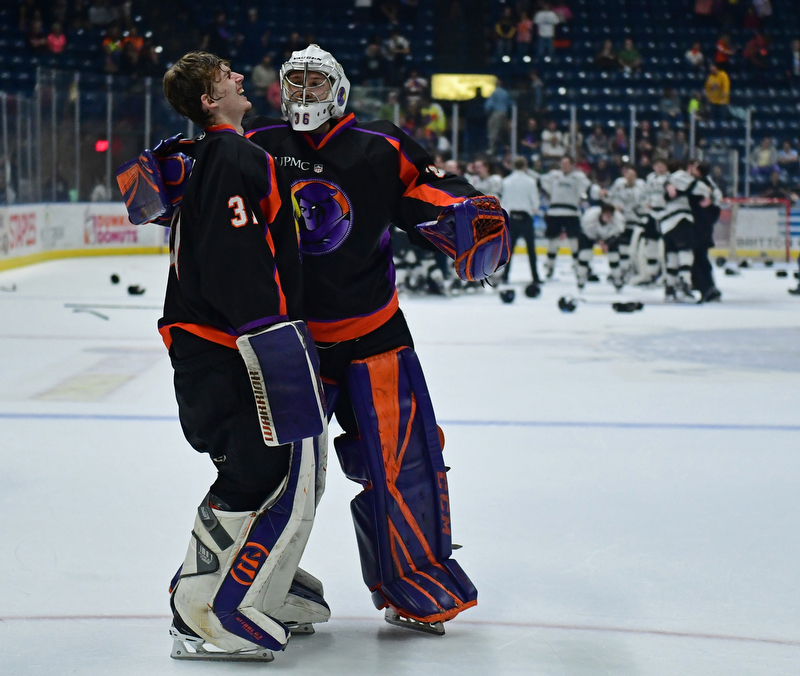 YOUNGSTOWN, OHIO - MAY 19, 2018: Youngstown goalie Ivan Prosvetov, left, is consoled by Wouter Peeters while members of the Fargo Force celebrate winning the league championship behind them, Saturday night at the Covelli Centre. DAVID DERMER | THE VINDICATOR