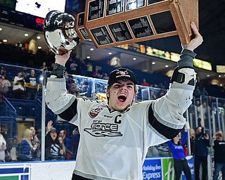 YOUNGSTOWN, OHIO - MAY 19, 2018: Fargo's Mark Senden celebrates with the Clark Cup after Fargo defeated Youngstown 4-2 to fin the USHL championship, Saturday night in Youngstown. DAVID DERMER | THE VINDICATOR