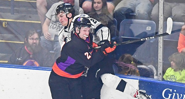 Phantoms forward Michael Regush pins Fargo's Robbie Stucker during Friday's game at the Covelli Centre. Fargo has a 2-1 series lead and the Phantoms must win tonight to force a Game 5 in North Dakota.