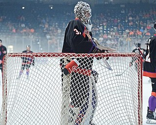 Youngstown goalie Ivan Prosvetov watches his teammates skate to disperse the fog that blanketed the Covelli Centre ice on Saturday. The Phantoms' USHL Clark Cup Final game against the Fargo Force was delayed three times in the first period because of dangerous conditions.