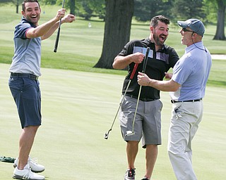 William D. Lewis The Vindicator  Lou Lyras of Poland, right,get congrats from George Rohan of Boardman, left, and Derek Knepper of Canfield after sinking a long putt on #9 at Tippecanoe 5-21-18 in GGOV scramble.