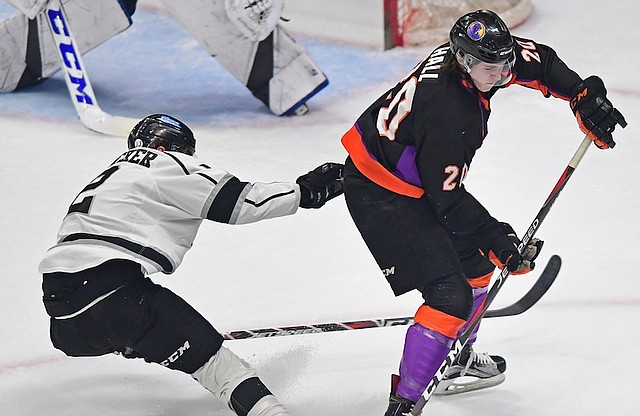 Phantoms forward Curtis Hall looks for the puck while being checked by Fargo's Robbie Stucker during Friday's game at the Covelli Centre. Hall is projected to be a fourth-round selection in June's NHL Draft.