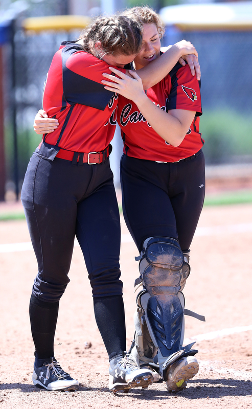 AKRON, OHIO- 05-23-18 SOFTBALL D1 Regional Semi- Canfield Cardinals vs Willoughby South Rebels: Canfield teammates Kailn Kovach(20) (left) and Chloe Cruz (32) (right) console each other after their defeat at University of Akron, Lee Jackson Softball Field.  MICHAEL G. TAYLOR | THE VINDICATOR