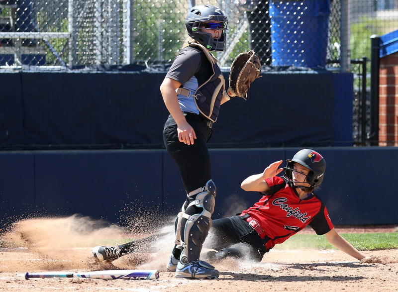 AKRON, OHIO- 05-23-18 SOFTBALL D1 Regional Semi- Canfield Cardinals vs Willoughby South Rebels: Canfield's Mary Gomez (4) scores during the 6th inning at University of Akron, Lee Jackson Softball Field.  MICHAEL G. TAYLOR | THE VINDICATOR