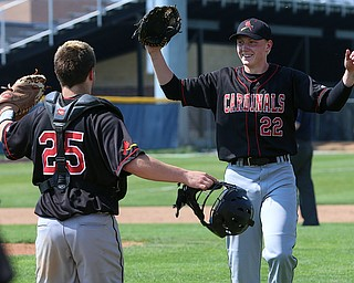 HUDSON, OHIO- 05-24-18 BASEBALL D2 Regional Semi- Chardon Hilltoppers vs Canfield Cardinals: Canfield's Angelo Petracci (25) and Ian McGraw (22) celebrate their victory  at The Ball Park at Hudson, Hudson High School.  MICHAEL G. TAYLOR | THE VINDICATOR