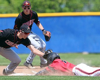 HUDSON, OHIO- 05-24-18 BASEBALL D2 Regional Semi- Chardon Hilltoppers vs Canfield Cardinals: Canfield's Jimmy Fitzgerald (32) applies the tag on a stolen base by Chardon's Luke Callahan (22) during the 1st inning at The Ball Park at Hudson, Hudson High School.  MICHAEL G. TAYLOR | THE VINDICATOR