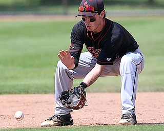 HUDSON, OHIO- 05-24-18 BASEBALL D2 Regional Semi- Chardon Hilltoppers vs Canfield Cardinals: Canfield's Nick Piersante (7) fields the grounder during the 3rd inning at The Ball Park at Hudson, Hudson High School.  MICHAEL G. TAYLOR | THE VINDICATOR