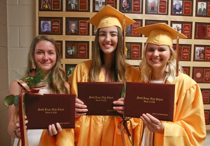 ROBERT K YOSAY  | THE VINDICATOR..South Range Class of 2018Õs , High School Principal Stephen P. Rohan described its 120 graduates a Òone of a kind class.Ó..bff  all with diplomas -  Nicole Winkel--Ana Luiza Justino -and Anna Marie Turnbull.show off their diplomas.-30-