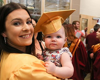ROBERT K YOSAY  | THE VINDICATOR..South Range Class of 2018Õs , High School Principal Stephen P. Rohan described its 120 graduates a Òone of a kind class.Ó..Happy Time for her niece as Lexie Davis holds Brynlee Davis   with her mortarboard......-30-