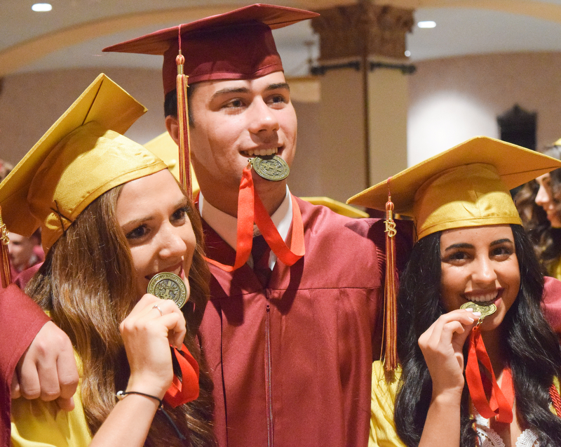 William D. Lewis The Vindicator Mooney grads from left, Julia Giamboi, Ryan Stefanec and Laura Emch clown around with their 4 year acedemic achievement medals before 5-27-18 commencement at Stambaugh.
