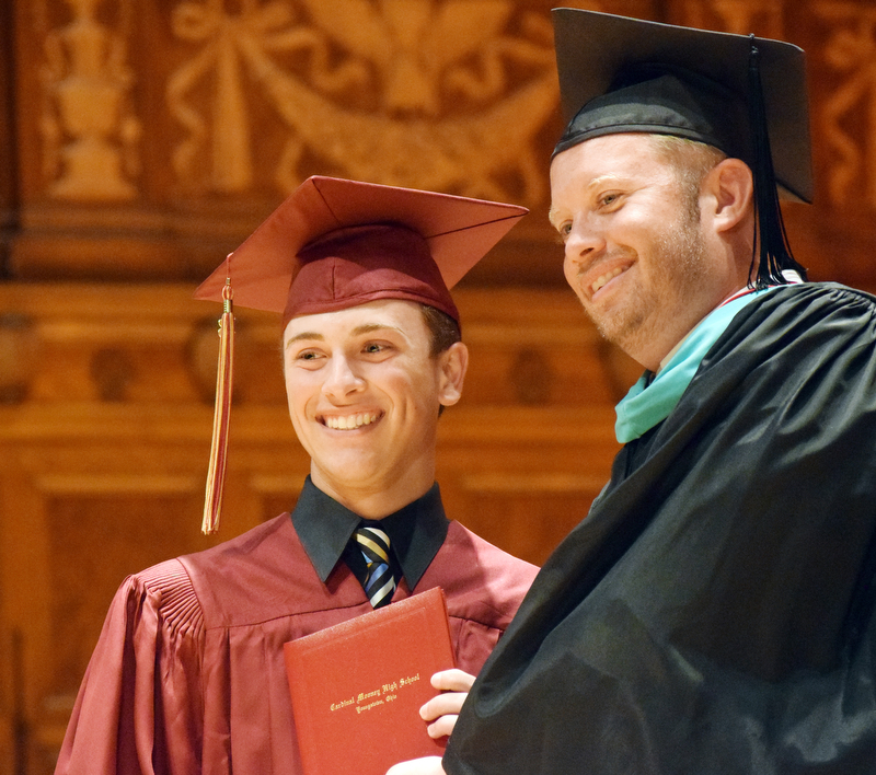 William D. Lewis The Vindicator Mooney principal MArk Vollmer opresents diploma to grad Vincent Anthony Pecchia during5-27-18 commencement.