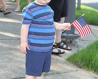 Jaxy Millerleile (1.5) of Poland holds a flag while watching the police cars go by during the Memorial Day Parade in Poland on Monday morning. Dustin Livesay  |  The Vindicator  5/28/18 Poland