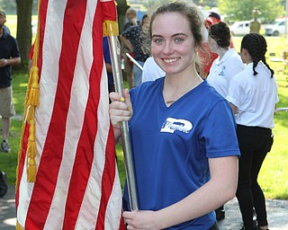 Olivia Barrett of the Poland Seminary flagline carries a flag during the Memorial Day Parade in Poland on Monday morning. Dustin Livesay  |  The Vindicator  5/28/18 Poland