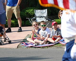 L-R) Finn Rousher (1), Madilynn Mikolich (7), Michael Mickley (6), and Galas Mikolich (6) all of Poland clap their hands as the veterans carry a flag at the begining of the Memorial Day Parade in Poland on Monday morning. Dustin Livesay  |  The Vindicator  5/28/18 Poland