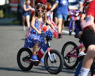 Brooklynn Simon (5) of Poland decorated her bike and rode in the Memorial Day Parade at Poland on Monday morning. Dustin Livesay  |  The Vindicator  5/28/18 Poland