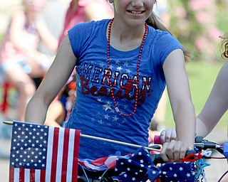 Alexis Antal (12) of Poland decorated her bike and rode in the Memorial Day Parade at Poland on Monday morning. Dustin Livesay  |  The Vindicator  5/28/18 Poland