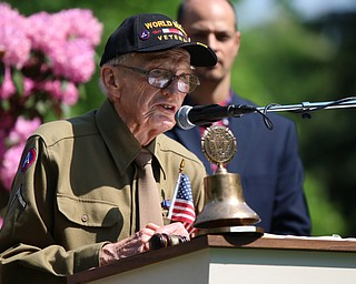 "World War II Veteran Howard ""Howdy"" Friend addresses the crowd gathered at the Riverside Cemetary for a Memorial Day Service in Poland. Dustin Livesay  