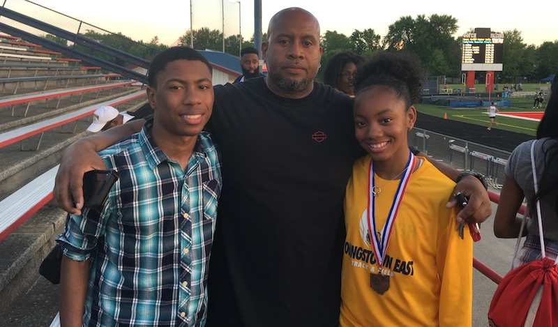 East's Laniya Lewis, right, with her father, Lawalyn Lewis, and twin brother, Lawalyn Jr., is heading to state as part of the Golden Bears' 4x200 relay. She wears a diamond ring around her neck to remember her late mother, Claretta Jackson.