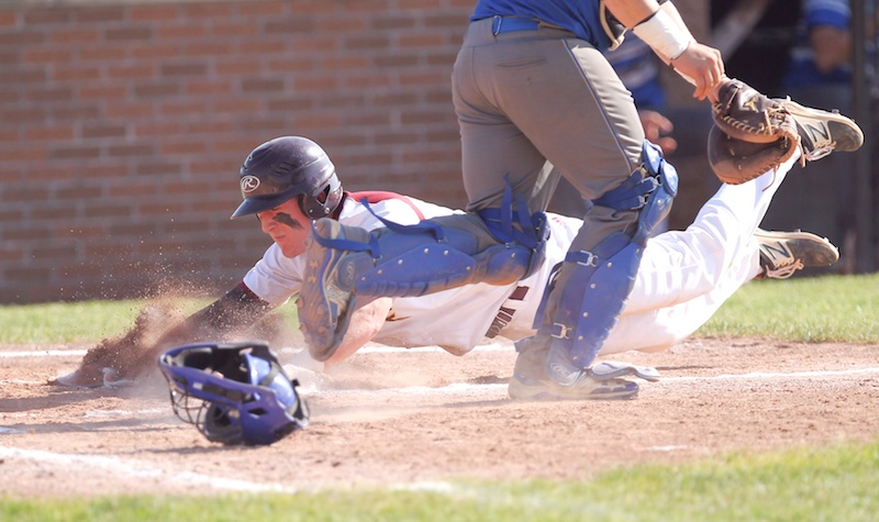 South Range baserunner Brycen James (5) slides safely into home plate during Friday's win over Grand Valley at Massilon High School. Thursday, the Raiders will make their first appearance in the state tournament.