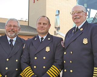 Boardman fire chiefs past and present — Jim Dorman, left, Chief Mark Pitzer and George Brown — attended Tuesday's opening of the township's new $3.6 million station No. 71 on Market Street next to Stadium Drive.