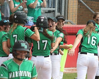 ROBERT K YOSAY  | THE VINDICATOR..West Branch Warriors - defeated Jonathan Alder Pioneers  - 5-4 where the lead changed hands several times ..WB  engulf Kyle  Coffelt as she tags home..-30-