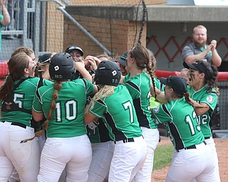 ROBERT K YOSAY  | THE VINDICATOR..West Branch Warriors - defeated Jonathan Alder Pioneers  - 5-4 where the lead changed hands several times ..WB  engulf Kylei Coffelt as she tags home..-30-
