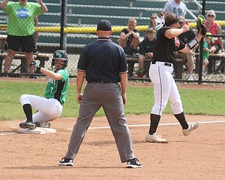 ROBERT K YOSAY  | THE VINDICATOR..West Branch Warriors - defeated Jonathan Alder Pioneers  - 5-4 where the lead changed hands several times ...WB 7 Grace Heath - checks with the umpire as she slides past the throw to Aldens 3rd Base  #33  Jillian Jake...during third inning action..-30-