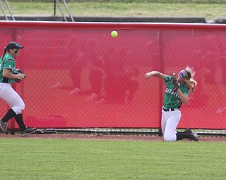 ROBERT K YOSAY  | THE VINDICATOR..West Branch Warriors - defeated Jonathan Alder Pioneers  - 5-4 where the lead changed hands several times .#7 Grace Heath throws from the warning track as #13 Hannah Sprague.. looks on..-30-