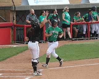 ROBERT K YOSAY  | THE VINDICATOR..West Branch Warriors - defeated Jonathan Alder Pioneers  - 5-4 where the lead changed hands several times ..#22 Delaney Rito.. looks over her shoulder as she scores the go ahead run for the second time.-30-