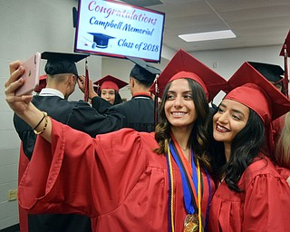 William D. Lewis  The Vindicator Campbell Grads Fotini Koullias, left, and Deena Diamandis nap a selfie before 5-31-18 commencement at Campbell HS.