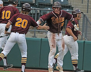 Jared Bajerski (18) of South Range celebrates with teammate Josh Stear after crossing home plate in the sixth inning during Thursday evenings State Semifinals matchup at Huntington Park in Columbus. Dustin Livesay  |  The Vindicator  5/31/18  Columbus