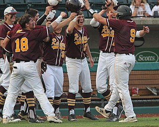 Jake Gehring (9) of South Range gets greeted by his teammates after hitting a 3-run double in the sixth inning during Thursday evenings State Semifinals matchup at Huntington Park in Columbus. Dustin Livesay  |  The Vindicator  5/31/18  Columbus