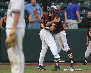 South Range senior first basemen Mike Cunningham (3) hugs his coach Jim Hanek after making it to third base and scoring a run in the sixth inning during Thursday evenings State Semifinals matchup against Madeira at Huntington Park in Columbus. Dustin Livesay  |  The Vindicator  5/31/18  Columbus