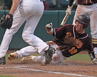 Jared Bajerski (18) of South Range slides in safely to home to extend the lead late in the State Semifinals matchup against Madeira during Thursday evenings State Semifinals matchup at Huntington Park in Columbus. Dustin Livesay  |  The Vindicator  5/31/18  Columbus
