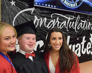 William D. Lewis The Vindicator  Canfield grad Thomas Beck shares a moment with fellow  grads Emerson Fletcher, left, and Christina Rivera before 6-1-18 commencement at CHS.