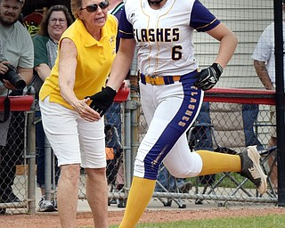 William D. Lewis Th Vindicator GAME WINNING RUN  Champion's Allison Smith(6) gets congrats from coach Cheryl Weaver while rounding 3rd after hitting homer in 8th inning during 6-1-18 win over North Union at Akron to advance to state championship game.