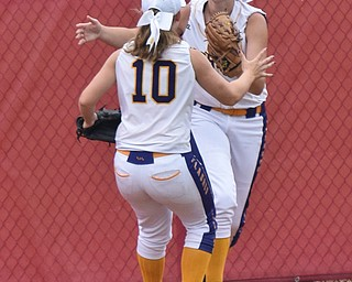 William D. Lewis Th Vindicator   Champion'Emma Gumount(1) gets congrats from Alayna Fell(10) after catching a long fly ball during 6-1-18 win over North Union at Akron to advance to state championship game.