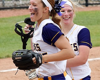 William D. Lewis Th Vindicator   Champion's Megan Turner(15), left, and pitcher Sophie Howell(14) react after 6-1-18 win over North Union at Akron to advance to state championship game.