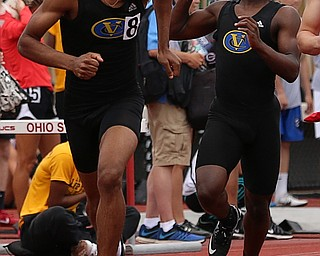 COLUMBUS, OHIO - June 1, 2018, OHSAA Track & Field Championships at Jesse Owens Stadium, Ohio State University-  D3 4x200 Youngstown Valley Christian's Jamynk Jackson hands the baton to his teammate Terrance White as YVC qualifies for the final.  SPECIAL TO | THE VINDICATOR