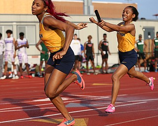 COLUMBUS, OHIO - June 1, 2018, OHSAA Track & Field Championships at Jesse Owens Stadium, Ohio State University-  D1 Youngstown East's Jahniya Bowers hands the baton to her teammate DeShante Allen as East qualifies for the 4x200m final.  SPECIAL TO | THE VIDICATOR